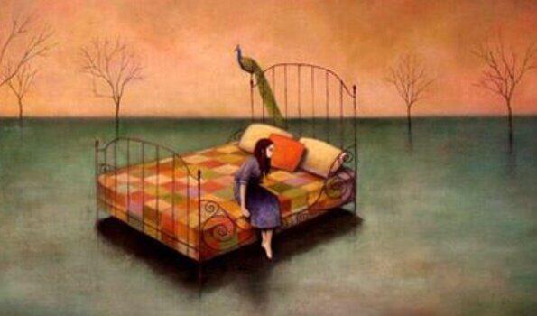 Mulher sentada em cama em meio à natureza