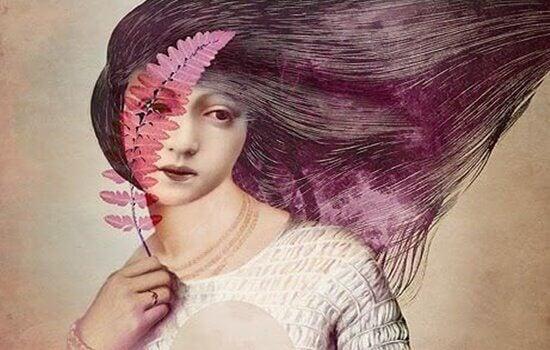 Mulher com folhas cor-de-rosa no rosto