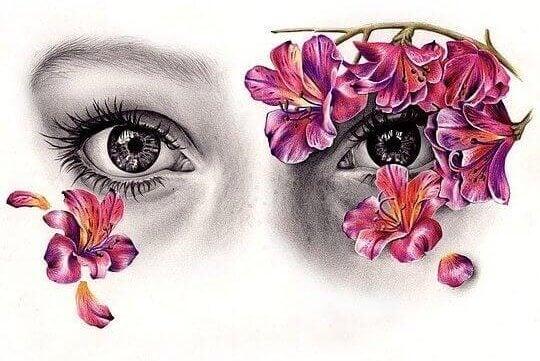 Olhos femininos com flores cor-de-rosa