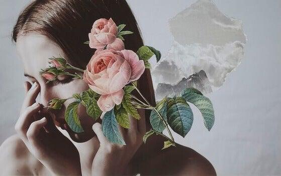 Mulher com flor no rosto