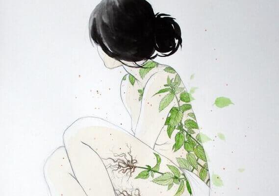 Mulher com folhas verdes no corpo