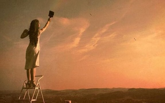 Mulher pintando o céu
