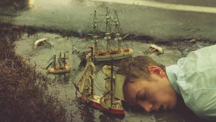 Homem dormindo e sonhando sobre poça de água