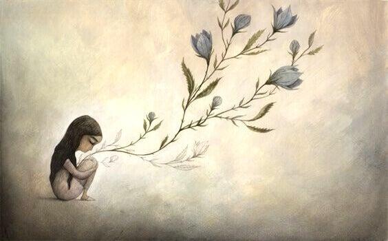 Menina segurando galhos de flores