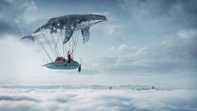 Dirigível com baleia voando