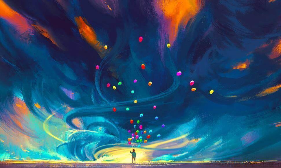 Homem soltando balões coloridos no céu