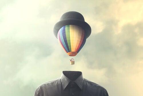 Homem com balão no lugar de cabeça