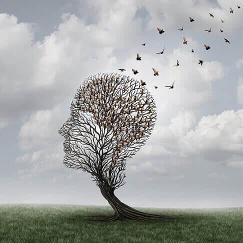 Pássaros voando de árvore em forma de cabeça