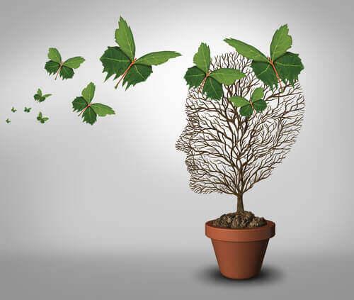 Borboletas de folhas em árvore em forma de cabeça