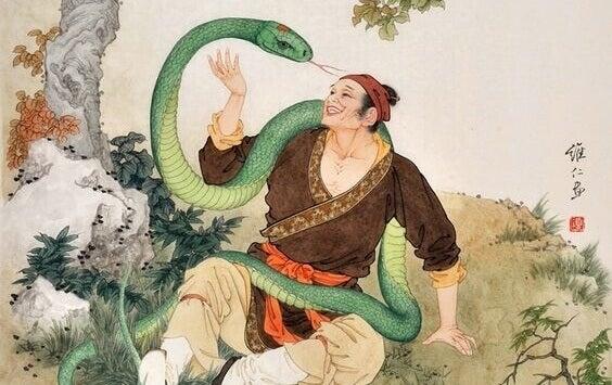 Serpente envolvendo homem