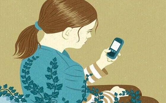Menina olhando seu celular