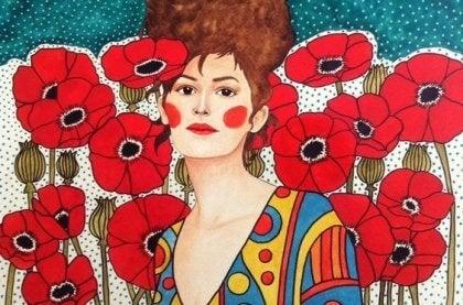 Mulher em jardim de flores vermelhas