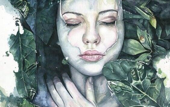 Mulher com metade do rosto sob a água