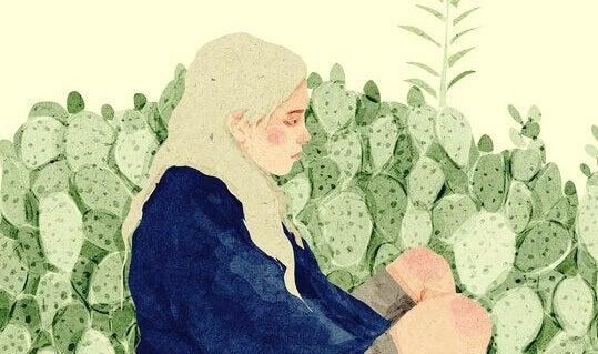 Mulher sentada em meio à natureza
