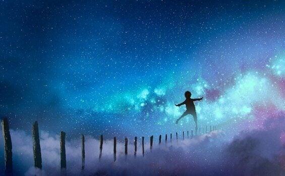 Menino cruzando limite dos sonhos