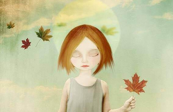Menina segurando flor de outono