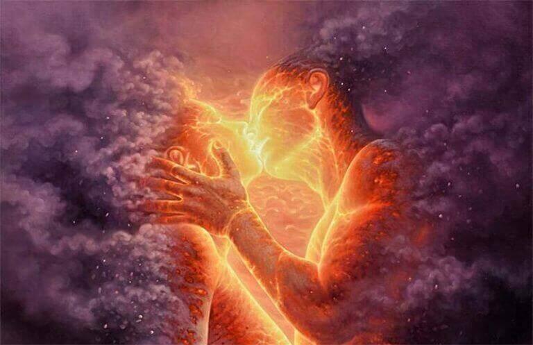 Homem e mulher de fogo se beijando
