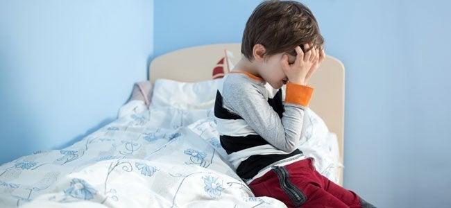 Criança doente em sua cama