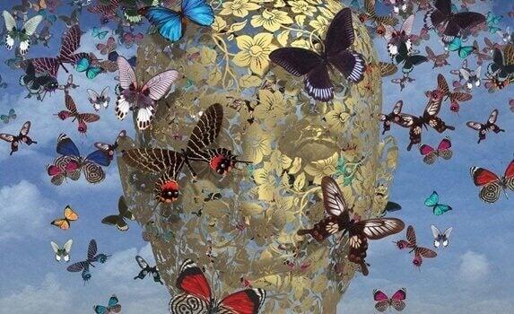 Cabeça envolta por borboletas voando