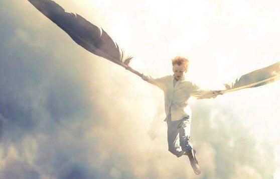 Criança voando segurando penas