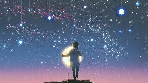 Criança observando as estrelas