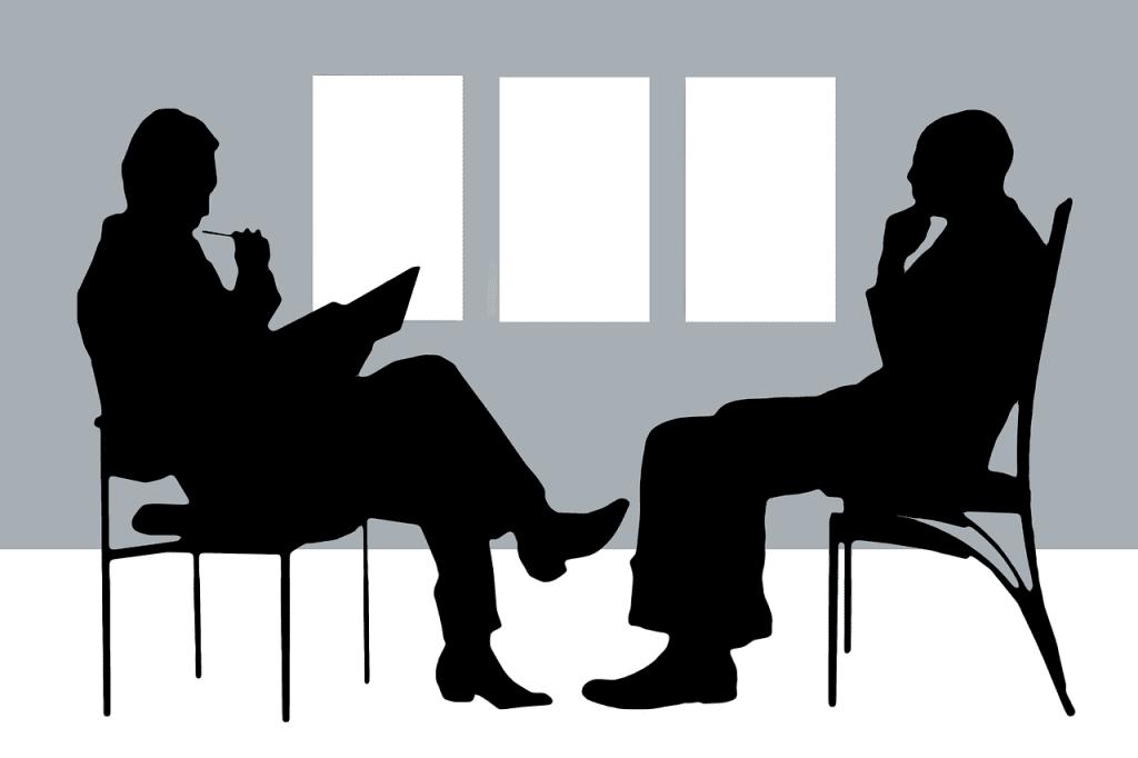 Desenho de dois contornos de figuras humanas em uma consulta de terapia