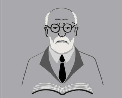 Freud segurando um livro